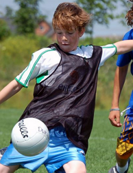 kid playing football